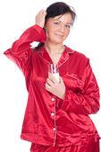 Kobieta w piżamie z szklankę mleka — Zdjęcie stockowe