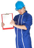 Man in overalls with clipboard — Stockfoto