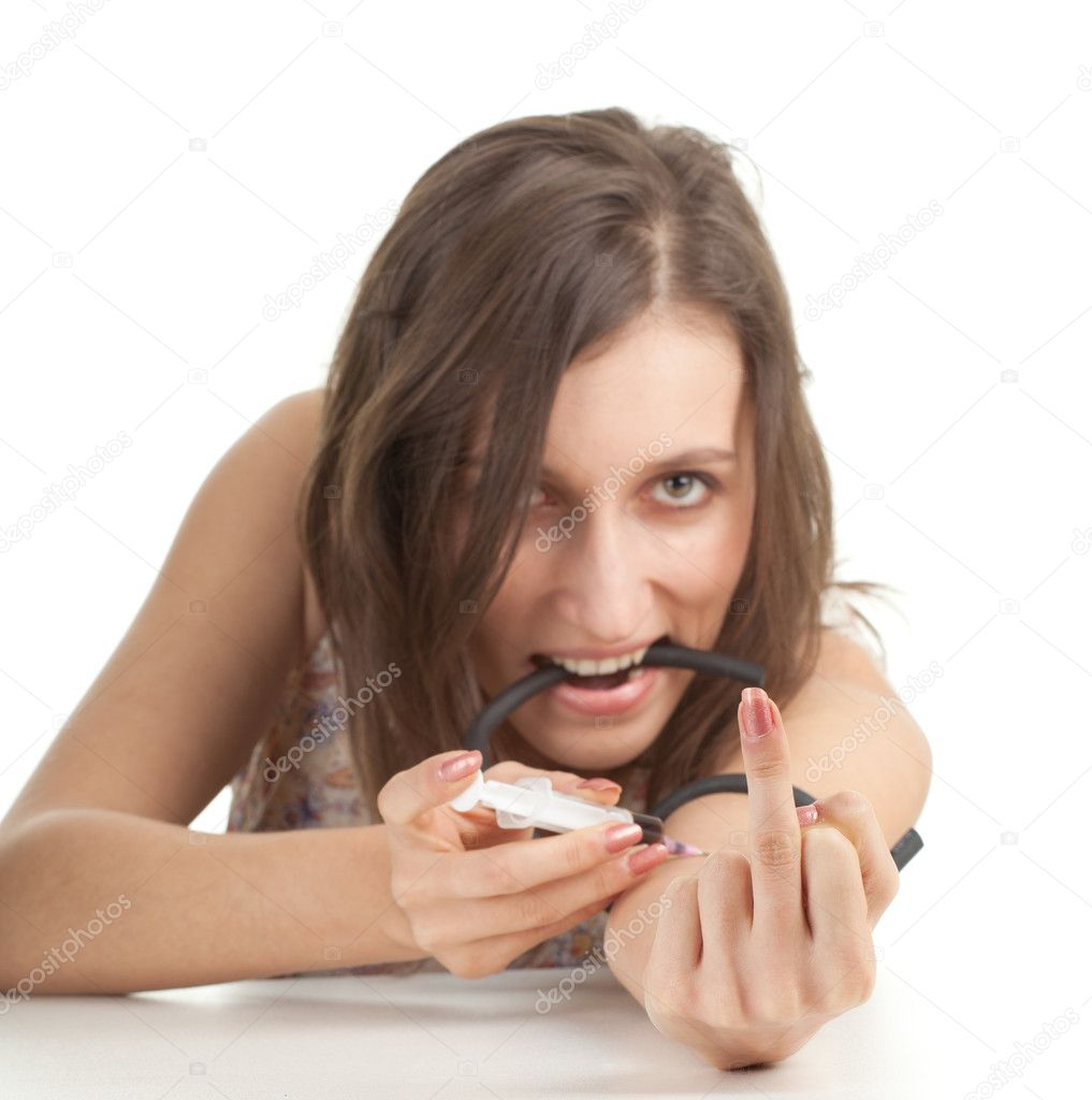 Drug addict young woman with brown hair in action   Stock Photo #5408759