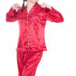 Yawning woman in red pajamas — Stockfoto