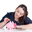 Fat girl with pink piggy bank — Stock Photo #5464946