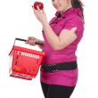 Fat girl with shopping basket — Stock Photo #5464954