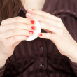 Woman removing varnish from nails — Stock Photo