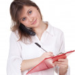 Young woman with clipboard - Stockfoto