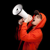 Screaming man with megaphone — Stock Photo