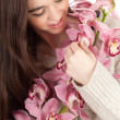 Beautiful girl with orchid - Stockfoto