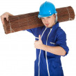 Man in coveralls with wicker mat - Stockfoto