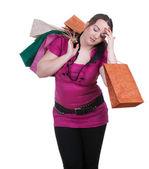 Trött fet tjej med kassar och påsar — Stockfoto