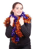 Smiling fat girl and Christmas chains — Stock Photo