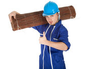 Man in coveralls with wicker mat — Stock fotografie