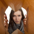 Angry young woman in paper bag — Stock Photo