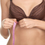 Woman measuring her waist — Stock Photo #5629668