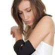 Woman with elbow in medical bandage — Stock Photo #5629685