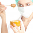 Female doctor with honey - Stock Photo