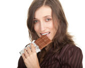 Young woman with chocolate — Stock Photo