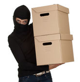 Thief in balaclava with boxes — Stock Photo