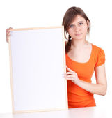 Beautiful girl with a blank sign — Stock Photo
