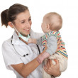 Female doctor examining baby boy — Stock Photo #5813494