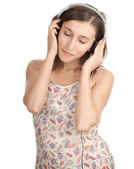 Young girl in headphones — Stok fotoğraf