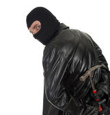 Male thief in balaclava with hammer — Stock Photo