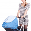 Stock Photo: Mother with baby carriage
