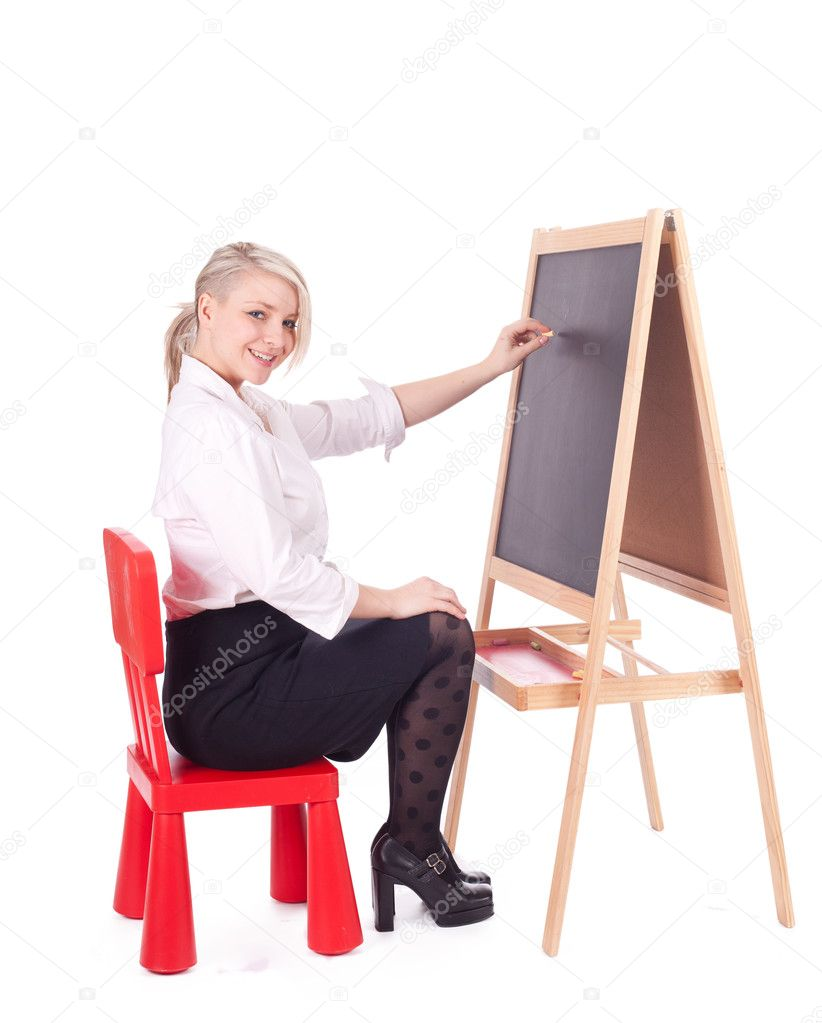 Young beautiful teacher woman writing on blackboard  — Stock Photo #6176889