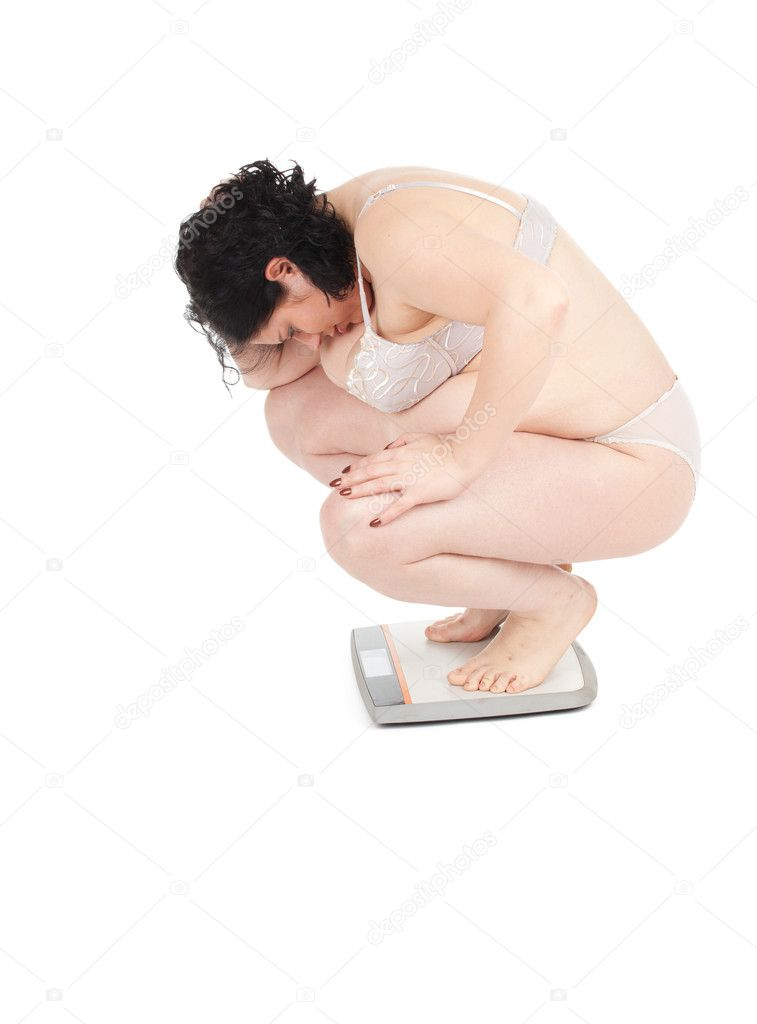 Squats on scale young fat woman in underwear, series  Stock Photo #6178083