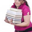 Stock Photo: Fat girl with pile of books