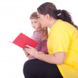Girl with fat mother and book — Stock Photo