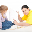 Drawing fat mother and little girl — Stock Photo