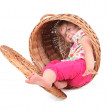 Little girl in wicker container — Stock Photo