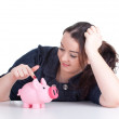 Fat girl with pink piggy bank — Stock Photo
