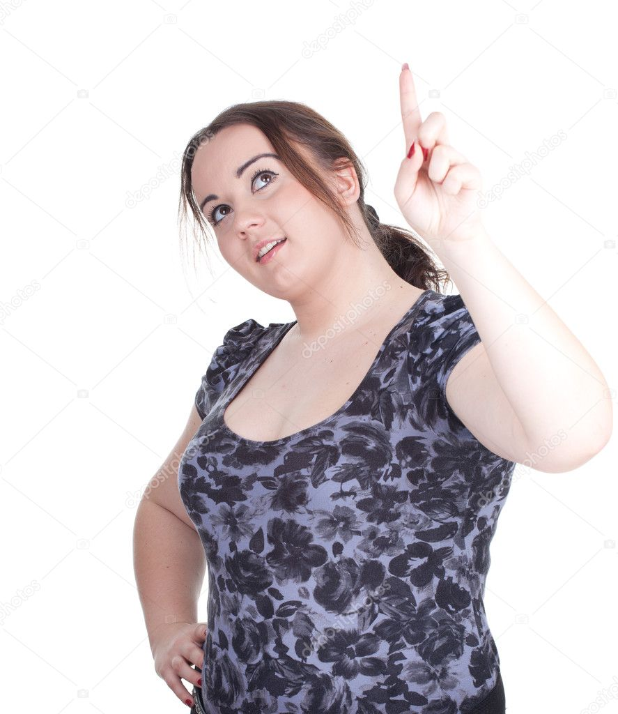 Smiling fat beautiful young woman in dark dress pointing — Stock Photo #6559845