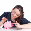 Royalty-Free Stock Photo: Fat girl with pink piggy bank