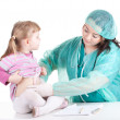 Little girl at fat doctor - Stock Photo