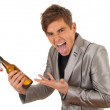 Young man with bottle of beer — Fotografia Stock  #6630372