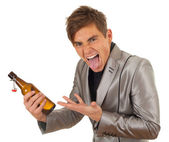 Young man with bottle of beer — Stock Photo