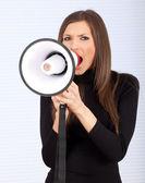 Jovem mulher com megafone — Foto Stock