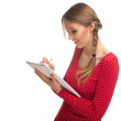 Stock Photo: Young woman with clipboard