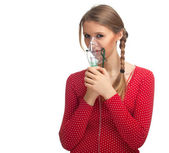 Young woman keeping inhale mask — Stock Photo
