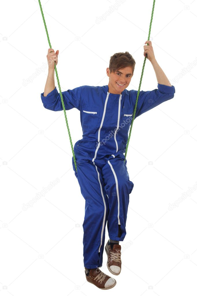 Young man in blue coveralls in acrobatic tricks on rope, series — Stock Photo #6686474