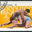 Poststamp Wrestling - Stock Photo
