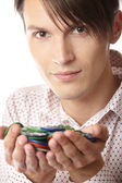 Man with casino chips — Stockfoto