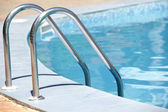Handrail of the public swimming pool — Stock Photo