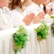 Children accepting the first Holy Communion — Stock Photo