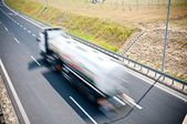 Truck is going along the asphalt highway — Stock Photo