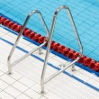 Metal handrail on swimming pool — Stock Photo