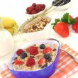 Royalty-Free Stock Photo: Muesli with milk, fresh fruits and nuts