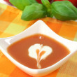 Tomato soup with dollop of cream — Stock Photo