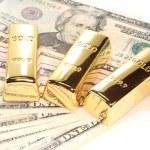 Постер, плакат: Three gold bars on dollar bills